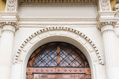 Window above the door with metal bars in the old town house Stock Photo