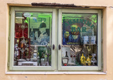 Window of an absinthe bar in Antibes, France. A street view of an absinthe bar with retro and vintage objects related with drinks Stock Image