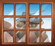 A window across the cliff with a tank Royalty Free Stock Photos