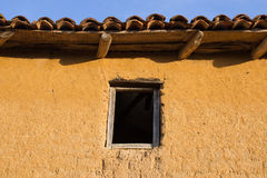 Window in Adobe House -. Mouth or window old wooden. House block or adobe or mud Stock Photo