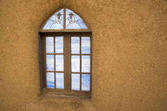 Window and Adobe. A window  on an adobe wall near Taos, New Mexico Stock Photography
