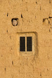 Window in Adobe Wall Royalty Free Stock Images