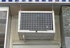 Window air conditioner. Unit above door Royalty Free Stock Photos