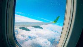 Window of an aircraft with a wing in it. HD stock footage