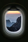 The window of airplane with travel destination attraction. Huang Royalty Free Stock Photos