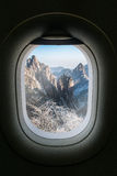 The window of airplane with travel destination attraction. Huang Stock Image