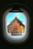 The window of airplane with travel destination attraction. Luang Royalty Free Stock Photography