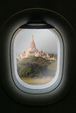 The window of airplane with travel destination attraction. Myanm Royalty Free Stock Image