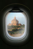The window of airplane with travel destination attraction. Myanm Royalty Free Stock Photography