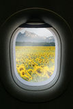The window of airplane with travel destination attraction. Royalty Free Stock Photography