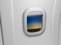 Window airplane view on sunset Royalty Free Stock Images