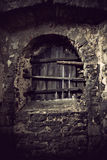 Window in ancient castle. Window of ancient castle sealed with planks Royalty Free Stock Image