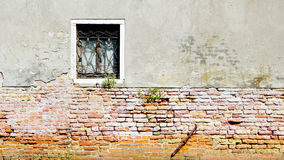 Window and ancient decay wall half brick wall Stock Images