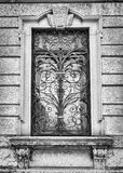 Window of an ancient Italian villa with artistic iron grill. Stock Images