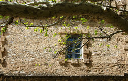 Window in the ancient stone wall Royalty Free Stock Image