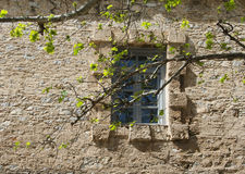 Window in the ancient stone wall Royalty Free Stock Photo