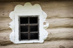 Window of ancient Ukrainian hut. Clay covered wall Royalty Free Stock Photography