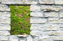 Window aperture in a wall from calcareous stones Royalty Free Stock Images