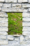 Window aperture in a wall from calcareous stones Stock Image