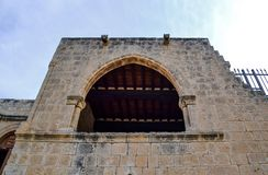 Window / arch high in the wall of an ancient castle. bottom view.  Stock Image