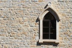 Window with an arch on the old wall in the city of Budva Royalty Free Stock Images