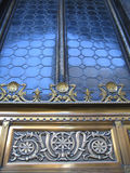 Window Art. A window with a beautiful artwork in gold and blue colors royalty free stock photography