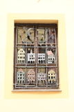 Window with art bars. Window with iron bars in shape of houses of Cesky Krumlov with moon and stars (Czech Republic Stock Photography