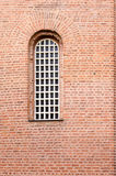 A window and a texture of a wall with red bricks Royalty Free Stock Images