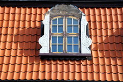 Window of attic on old tiled roof Royalty Free Stock Photo