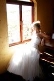 Window B. A bride sitting next to a window royalty free stock photos