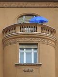 Window and balcony with blue sunshade Stock Photo