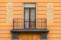 Window and balcony on facade of apartment building Stock Photo