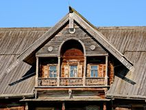 Window and balcony old log hut. Log hut facade, fragment. Woodcarving. Closeup. Wooden architecture Russia. Kizhi Pogost on Kizhi stock photography