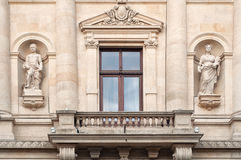 Window with balcony and statues. Detail of a window with balcony and statues Royalty Free Stock Photo