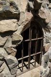 Window barred up at Bishops Castle in Colorado. This is a window barred up on Bishops Castle. The construction  of this castle is made by one man, Jim Bishop Stock Photography