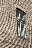 Window with bars on brick wall Stock Photo