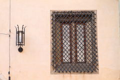 Window with bars and lamp Stock Photo