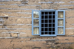 Window with bars on old house Royalty Free Stock Photography