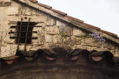 Window with bars in the old house. Old town of Kotor, Montenegro Royalty Free Stock Photography