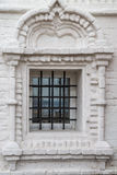 Window with bars in the Orthodox Church of white washed brick. Space to insert text Royalty Free Stock Image