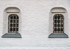 Window with bars in the Orthodox Church of white washed brick. Space to insert text Royalty Free Stock Photos