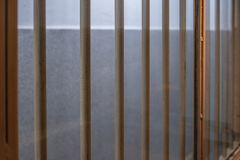 Bars on the window in the prison. Window with bars in the prison corridor, cell, jail, penitentiary, justice, criminal, old, building, crime, interior, security stock photo