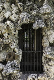 Window with bars of a prison of stone Stock Photography