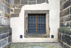 Window with bars set in an old fortress wall Royalty Free Stock Images