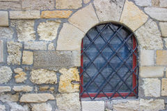 Window with bars in the stone wall Royalty Free Stock Image