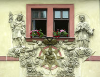 Window with bas-relief. Of old house in Prague, Czech Republic stock photo