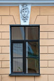 A window with a bas-relief. Royalty Free Stock Photography