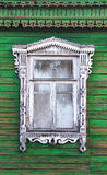 Window with beautiful fretted wooden case (nasus). It's a traditional decoration of old russian wooden houses Stock Image