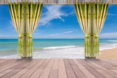 Window with beautiful green curtains and wood floor interior. Royalty Free Stock Image