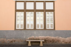 Window and bench of the old house Royalty Free Stock Image